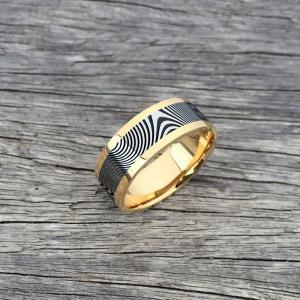 Damascus steel ring with an 18ct yellow gold liner and rails. Dark etched Damascus.