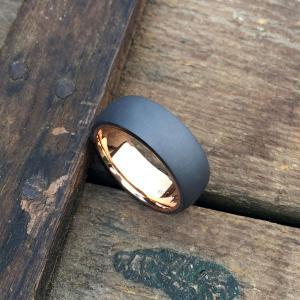 Sandblasted tantalum ring with an 18ct rose gold liner.