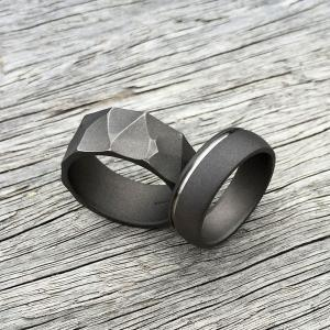 Sandblasted titanium ring with natural silver band & Distressed titanium ring.