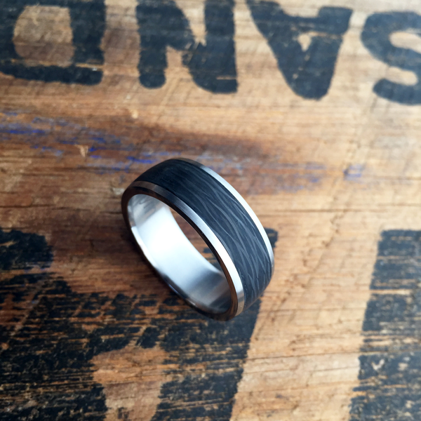 Custom carbon fibre ring with titanium liner and rails. $990 + shipping - all sizes.