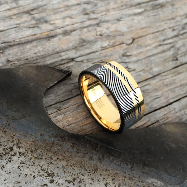 Custom Damascus steel ring with an 18ct yellow gold liner and single rail + inlay. Prices start at $2190 for up to and inc. size T.
