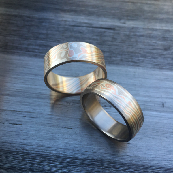 Pure mokume-gane ring + Pure with titanium liner and rails. Featuring rose gold, white gold and silver mokume. Pricing varies - contact us for a quote.