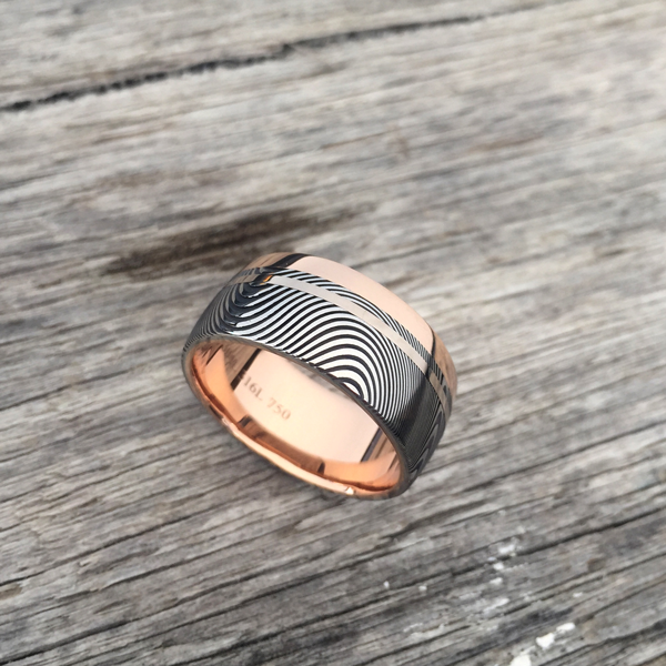 Custom Damascus steel ring with an 18ct rose gold liner and single rail + 18ct white gold inlay. Prices start at $2190 for up to and inc. size T.