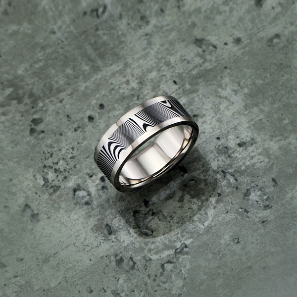 Damascus steel ring with an 18ct white gold liner and rails, in a dark etch and flat profile. Price depends on size - see pricing tab below.
