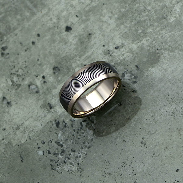 Damascus steel ring with an 18ct white gold liner and rails, in a dark etch and round profile. Price depends on size - see pricing tab below.