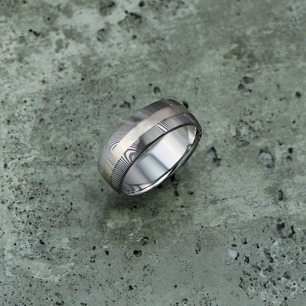 Damascus steel ring with an 18ct white gold central inlay, in a light etch and round profile. $1550 + shipping.