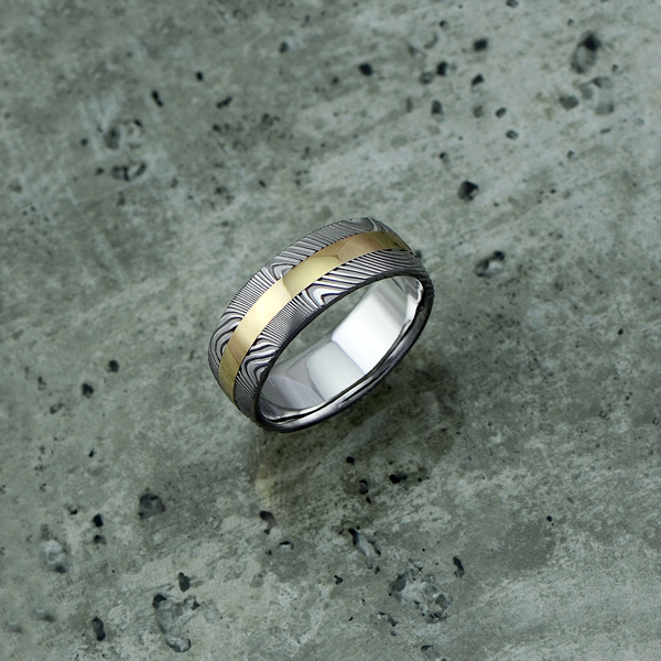 Damascus steel ring with an 18ct yellow gold central inlay, in a light etch and round profile. $1550 + shipping.
