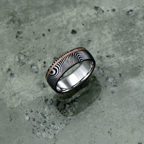 Damascus steel ring with an 18ct rose gold off-centre inlay, in a dark etch and round profile. $1350 + shipping.