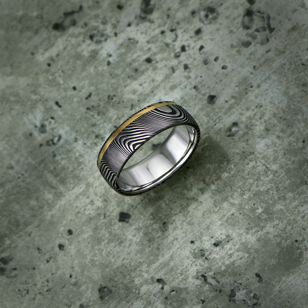Damascus steel ring with an 18ct yellow gold off-centre inlay, in a dark etch and round profile. $1350 + shipping.