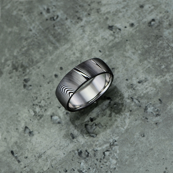 Pure Damascus steel ring, in a dark etch and round profile. $990 + shipping.