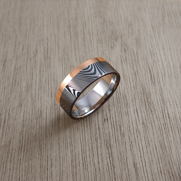 Damascus steel ring with a single 18ct rose gold rail, in a dark etch and flat profile. $1550 + shipping.