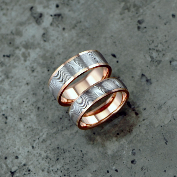 Damascus + liner & rails design in 18ct rose gold. Featuring a light etch and round profile. Prices dependent on size - see pricing tab below.