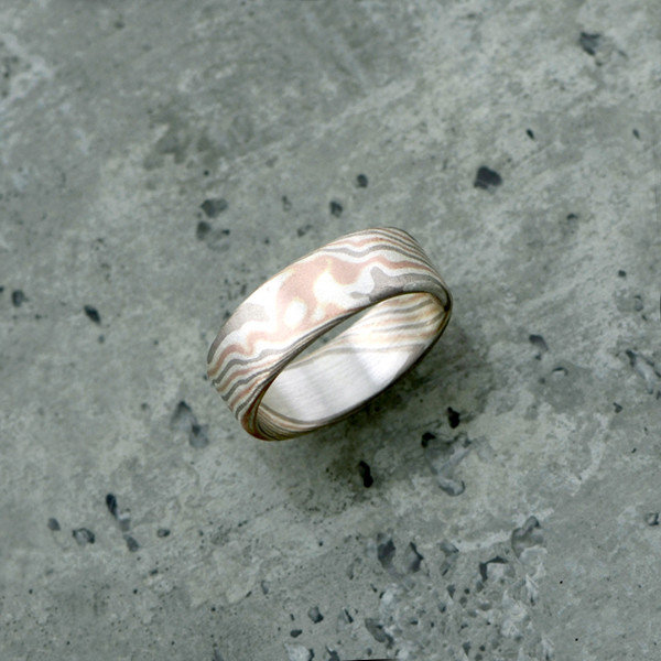 Mokume-Gane ring featuring rose gold, white gold and silver, in a matt finish and round profile. Pricing starts at $1990 - see pricing tab below.