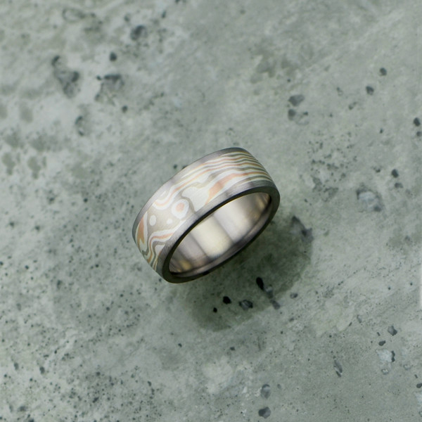 Mokume-gane ring with titanium liner and rails. Featuring rose gold, white gold and silver mokume. Pricing starts at $1790 - see pricing tab below.