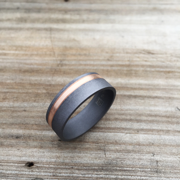 Sandblasted tantalum + 18ct gold inlay ring. Comes in rose, yellow or white gold. Made 7-9m wide. $1480-$1550 + shipping (based on width).