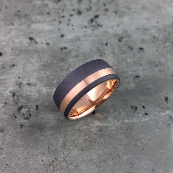 Sandblasted tantalum + 18ct gold liner & inlay. Comes in yellow, white or rose gold. Prices starts at $2040 for sizes up to & inc. T at 7.5-8.5mm wide.