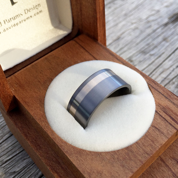 Tantalum + 18ct white inlay ring. Comes in rose, yellow or white gold. Made 7-9m wide. $1480-$1550 + shipping (based on width).