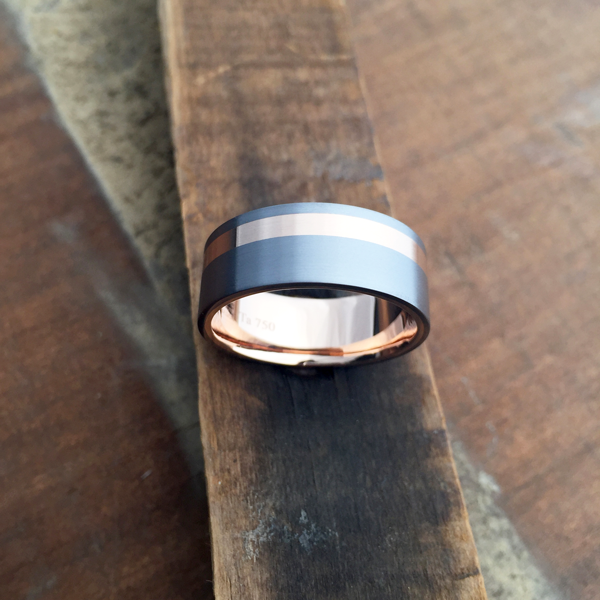 Tantalum + 18ct rose gold liner & inlay. Comes in yellow, white or rose gold. Prices starts at $2040 for ring sizes up to and inc. T at 7.5-8.5mm wide.
