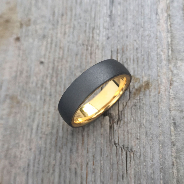 Sandblasted tantalum ring with 18ct yellow gold liner. 7.5-8.5mm wide. From $1650 for sizes up to and inc. T + shipping.