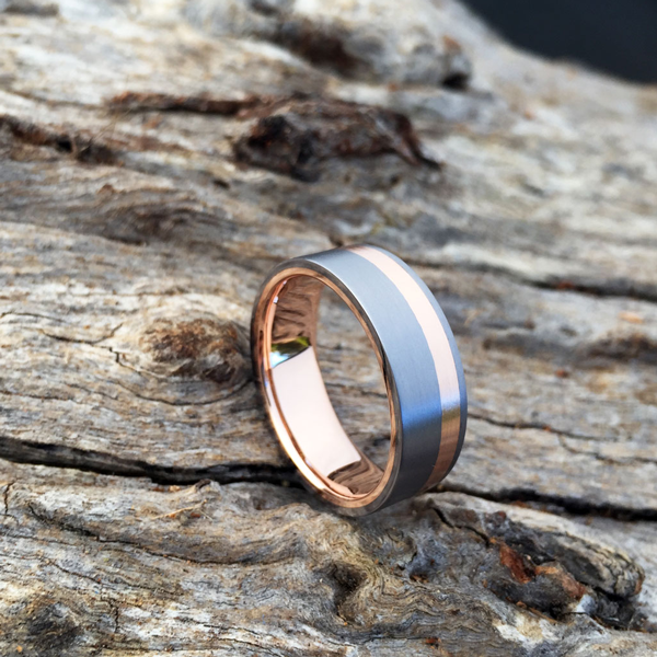 Tantalum + 18ct rose gold liner & inlay. Comes in yellow white or rose gold. Prices starts at $2030 for ring sizes up to and inc. T at 7-8mm wide.