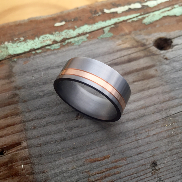 Tantalum + scored 18ct gold inlay ring. Comes in rose, yellow or white gold. Made 7-9m wide. $1480-$1550 + shipping (based on width).