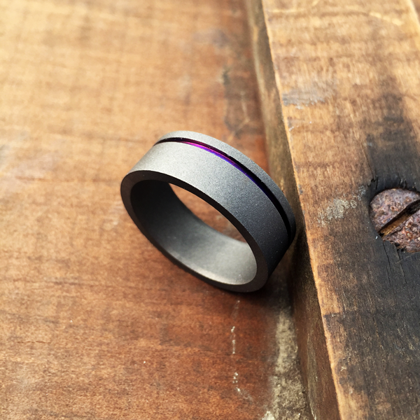 Sandblasted titanium ring with single band in blue, gold, purple or natural silver. 7-10mm wide. Round or flat profile. $550 + shipping – all sizes.