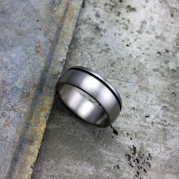 Brushed titanium ring with a sandblasted band. 7 - 8.5mm wide. Round or flat profile. $550 + shipping - all sizes.