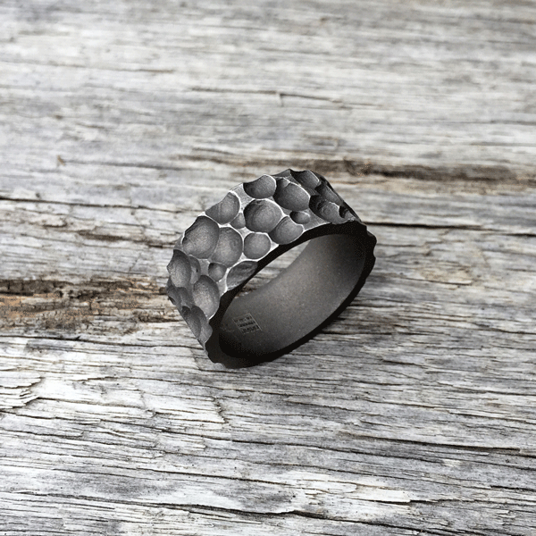 Moonscape titanium ring. Sandblasted finish with worn peaks. 8-9mm wide. $550 + shipping – all sizes.