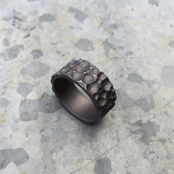 Moonscape titanium ring. Sandblasted finish with worn peaks. 8.5-10mm wide. $550 + shipping – all sizes.