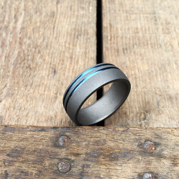 Sandblasted titanium ring with dual bands in silver, blue, gold or purple. 8.5-10mm wide. Round or flat profile. $550 + shipping – all sizes.