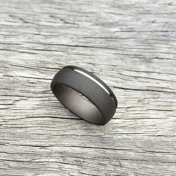 Sandblasted titanium ring with single band. 7-8.5mm wide. Round or flat profile. $550 + shipping – all sizes.