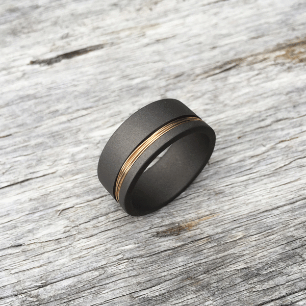 Wired titanium ring. 9ct yellow gold wire. Sandblasted finish. Round of flat profile. 8.5-10mm wide. $750 + shipping – all sizes.