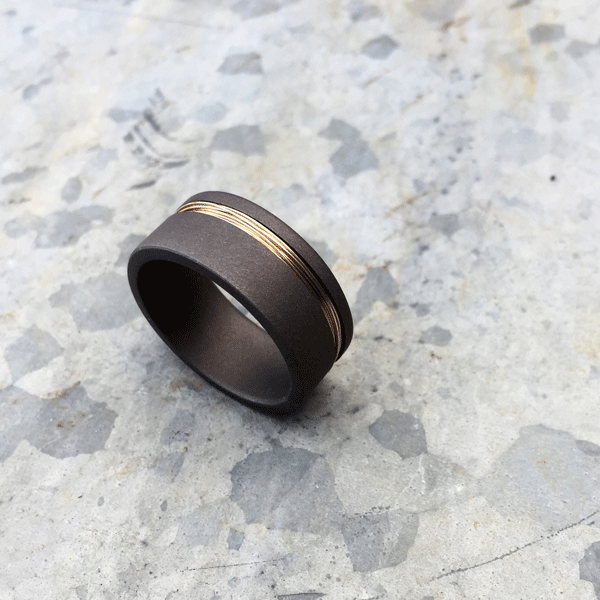 Wired titanium ring. 9ct yellow gold wire. Sandblasted finish. Round of flat profile. 8.5-9mm wide. $750 + shipping – all sizes.