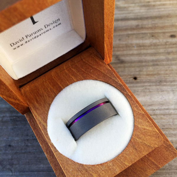 Sandblasted titanium ring with single band in silver, blue, gold or purple. 7-9mm wide. Round or flat profile. $550 + shipping – all sizes.
