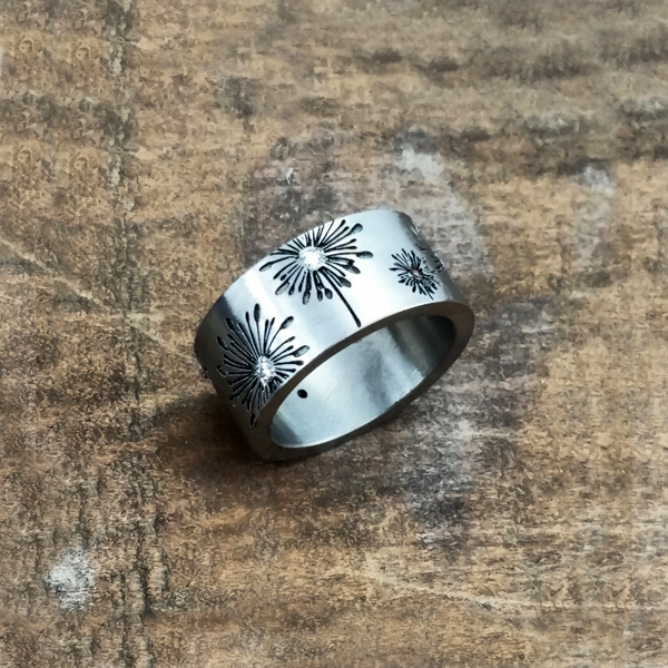 Titanium dandelion ring with diamond and yellow gold accents. $1500 + shipping - all ring sizes. Also available in tantalum for $2000.