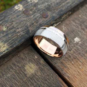 Custom Damascus steel ring with an 18ct rose gold liner and rail, plus 18ct white gold inlay.