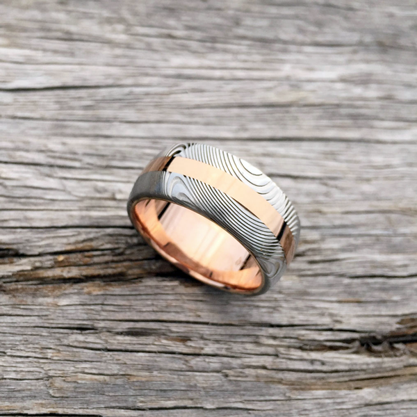 Damascus steel ring + 18ct rose gold central inlay & liner. Light etch & round profile. From $1990 + shipping. Contact us for quote.