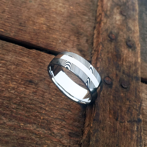 Damascus steel ring + 18ct white gold central inlay. Dark etch & round profile. $1550 + shipping - all sizes.