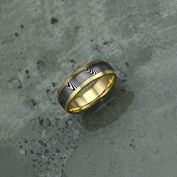 Damascus steel ring with 18ct yellow gold liner and rails. Dark etch with a round profile. Price depends on size - see pricing tab below.
