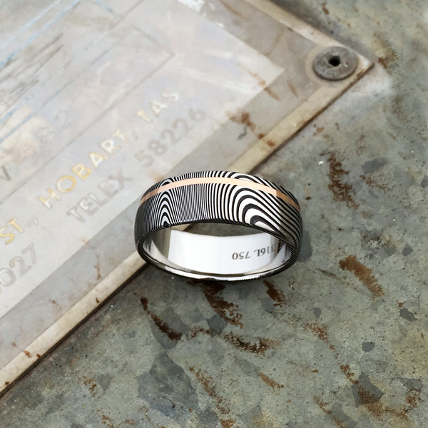 Damascus steel ring + 18ct rose gold off-centre inlay. Dark etch & round profile. $1350 + shipping - all sizes.