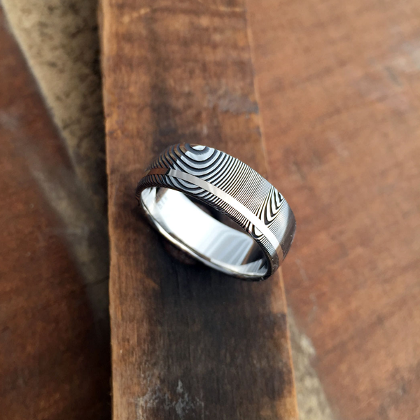 Damascus steel ring + 18ct white gold off-centre inlay. Dark etch & round profile. $1350 + shipping - all sizes.