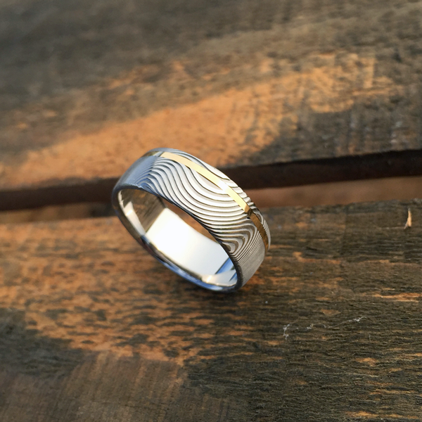 Damascus steel ring + 18ct yellow gold off-centre inlay. Light etch & round profile. $1350 + shipping - all sizes.