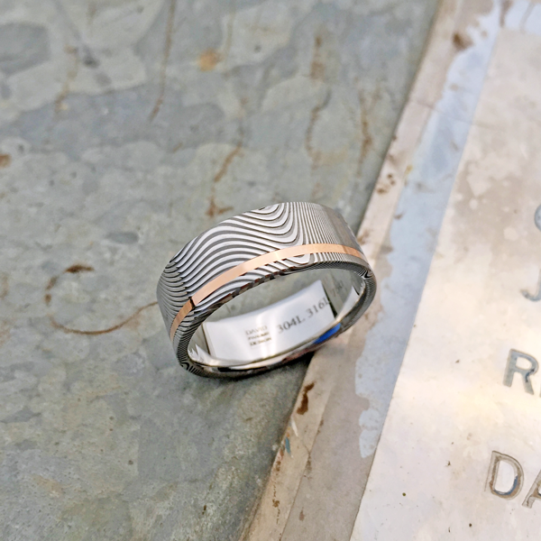 Damascus steel ring + 18ct rose gold off-centre inlay. Light etch & flat profile. $1350 + shipping - all sizes.