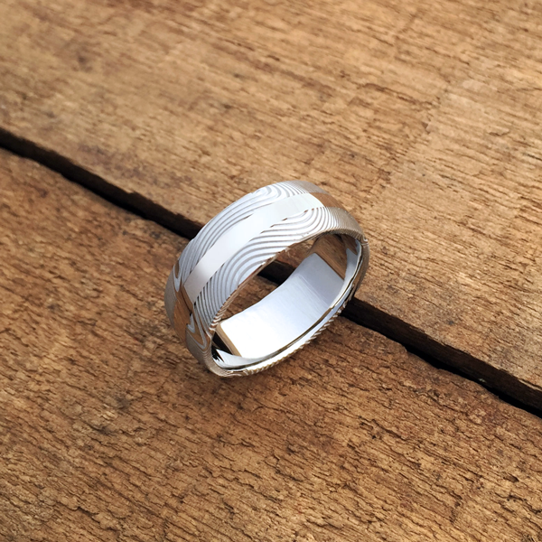 Damascus steel ring + 18ct white gold central inlay. Light etch & round profile. $1550 + shipping - all sizes.