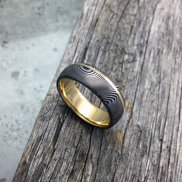 Damascus + 18ct yellow gold liner and inlay. Dark etch. Round profile. From $1990 - see pricing tab below.