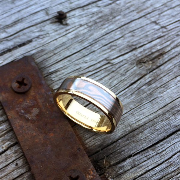Mokume-gane ring with 18ct gold liner and rails. Featuring rose gold and palladium mokume. POA - contact us for a quote.