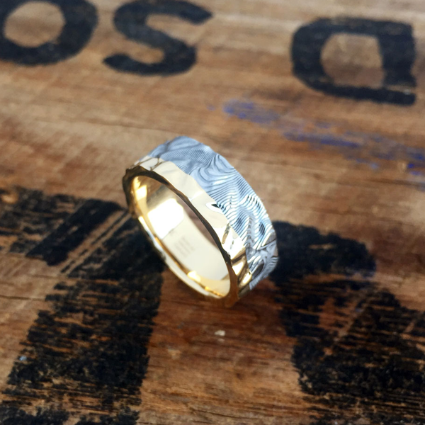 Custom rough finish Damascus steel ring with an 18ct yellow gold liner and rail (light etch only). Prices start at $1990 for up to and inc. size T .