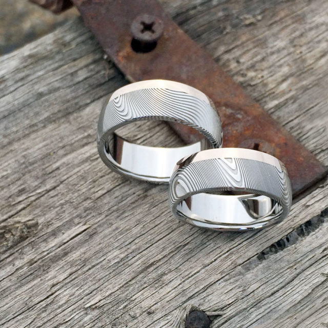 Damascus steel ring + 18ct white gold single rail. Light etch and round profile. $1550 + shipping - all sizes.