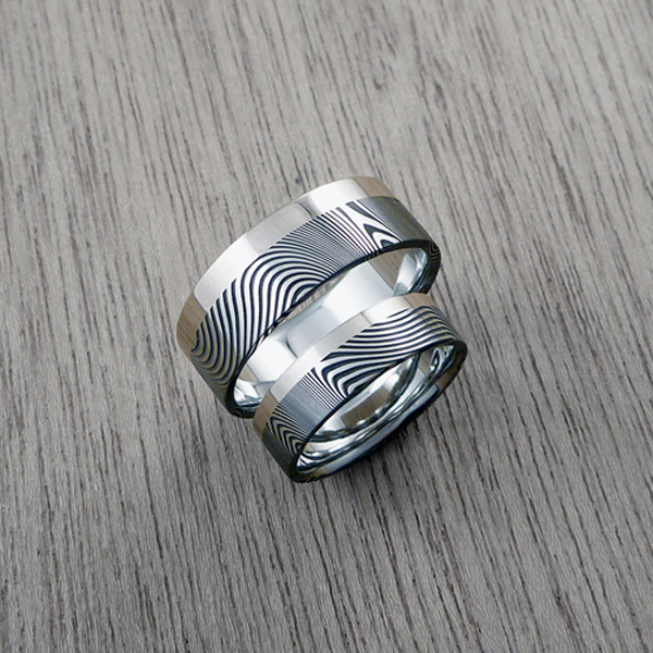 Damascus steel ring + 18ct white gold single rail. Dark etch & flat profile. $1550 each + shipping - all sizes.