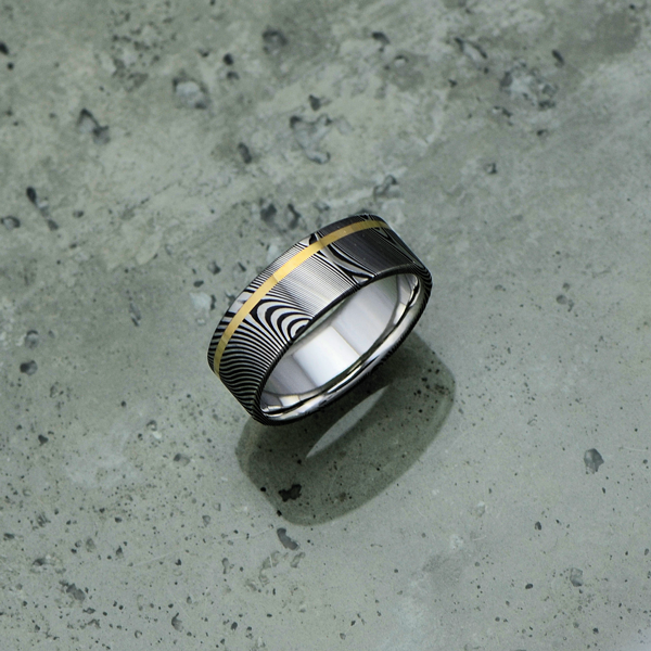 Damascus steel ring with an 18ct yellow gold off-centre inlay, in a dark etch and flat profile. $1350 + shipping.